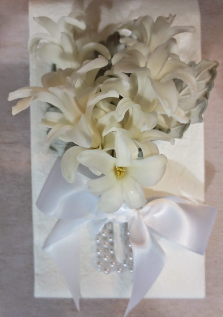 #7 White Hyacinth with silver leaf accent $60.00