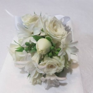 White rose wrist corsage with white hyacinths