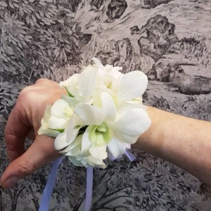 white rose wrist corsage with white orchids